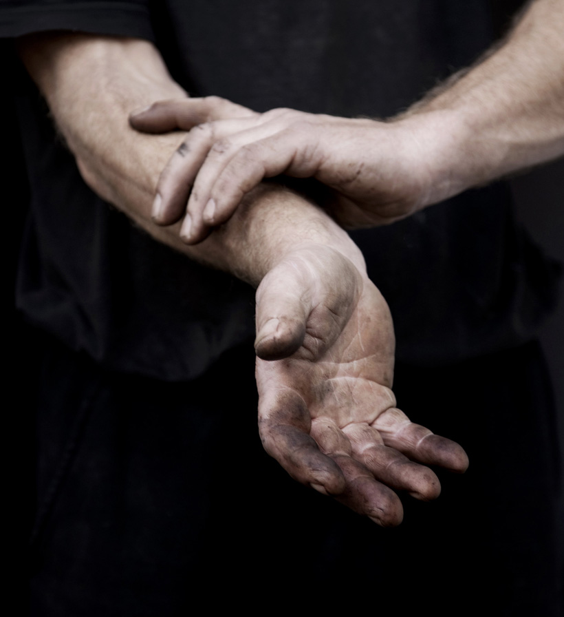 Hands of bicycle repairman